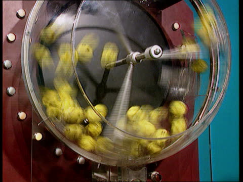 sponsorship by littlewoods pools int cms numbered balls drop into clear plastic ball mixer cms balls being mixed tx cms national lottery ticket being... - lottery stock videos and b-roll footage