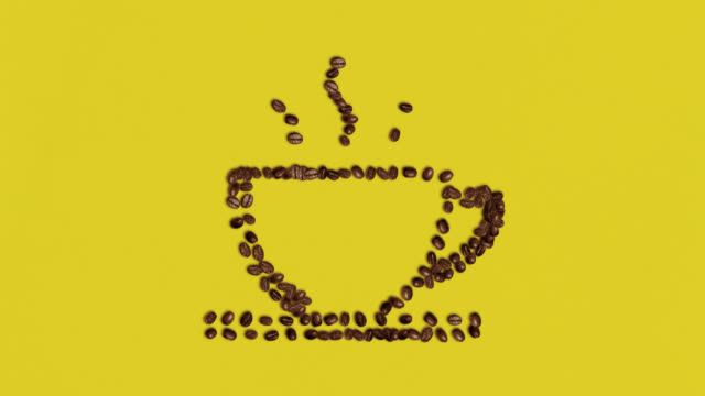 cup symbol shaped coffee bean on yellow background - yellow stock videos & royalty-free footage