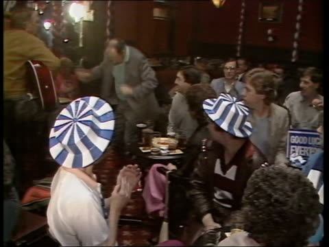 liverpool ms man dancing on table in pub bar hung with banners everton for the cup/liverpool for the cup cms woman wearing liverpool hat waving arms... - dj stock videos & royalty-free footage