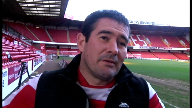 preview south yorkshire sheffield bramall lane ext nigel clough walking through empty stands with unidentified man nigel clough interview sot - south yorkshire stock videos and b-roll footage