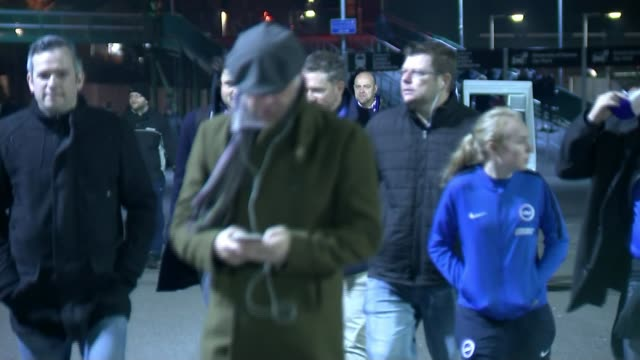 cup third round / video assistant referee trial; east sussex: brighton: falmer stadium: ext / night brighton fans arriving at stadium ahead of... - var stock videos & royalty-free footage