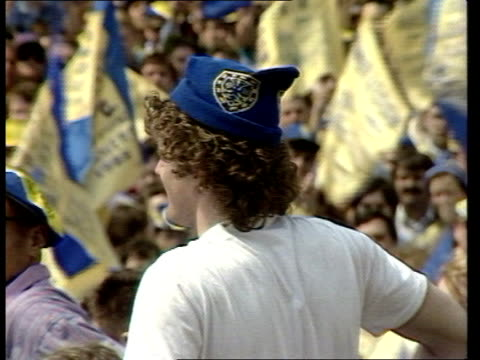 wimbledon:; england: london: wimbledon: ext tbv crowds of supporters waving flags as open top bus carrying team towards around corner zoom in players... - vinnie jones stock videos & royalty-free footage