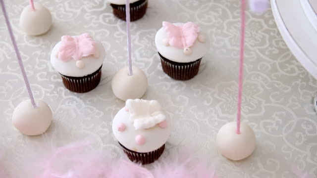 cupcake for a little girl - baby shower stock videos and b-roll footage