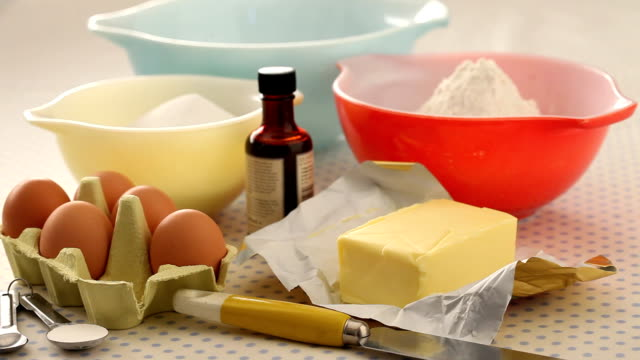 cu cupcake ingredients place on table / london, uk - table knife stock videos & royalty-free footage