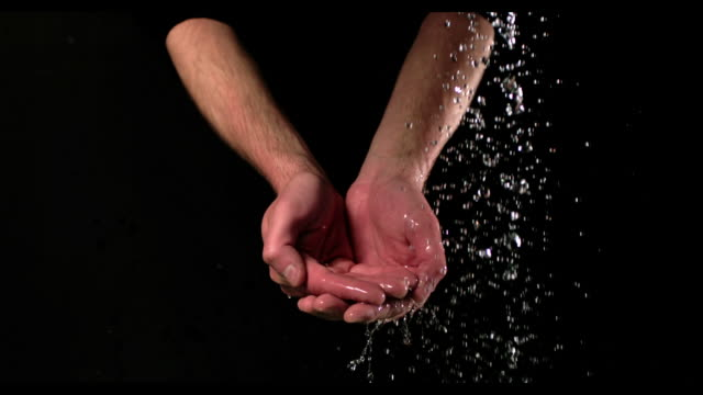 Cupped hands under running water