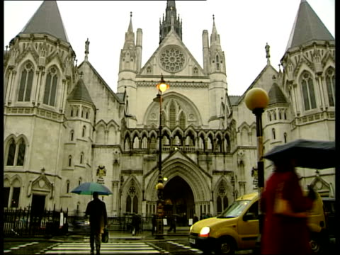 curate wins abortion ruling itn london royal courts of justice reverend joanna jepson along thru press pack to court sot gv entrance to high court... - income tax stock videos and b-roll footage