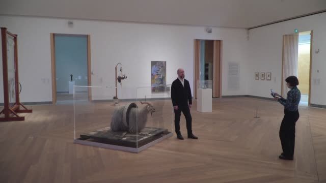 curator at stockholm's moderna museet, the city's contemporary art museum, gives an online guided tours of robert rauschenberg's monogram, answering... - curator stock videos & royalty-free footage