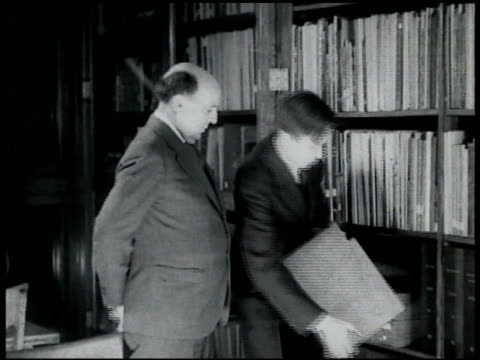 curator & musicologist john lomax w/ son folklorist & musicologist alan lomax putting recodings on shelf. - curator stock videos & royalty-free footage