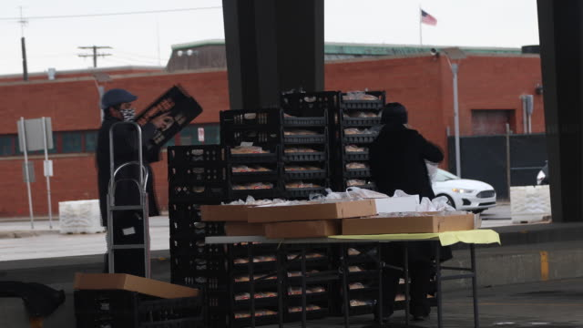 curbside grocery shopping pickup at eastern market in detroit and a michigan health professionals covid19 drive through testing site in detroit mi us... - rinnsteinkante stock-videos und b-roll-filmmaterial