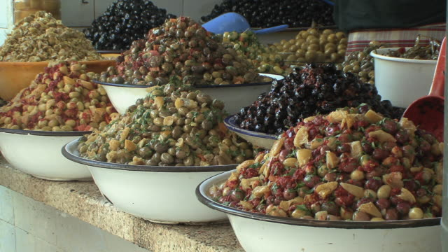 cu cured olives on stall, fez, morocco - food and drink stock videos & royalty-free footage