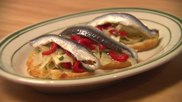 cured white anchovies boquerones dish at mfk restaurant in chicago on nov 12 2014 - anchovy stock videos & royalty-free footage