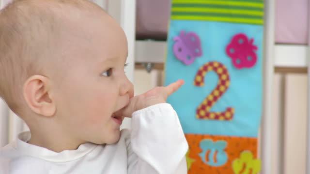 HD: Curious Baby Boy Looking Around Nursery