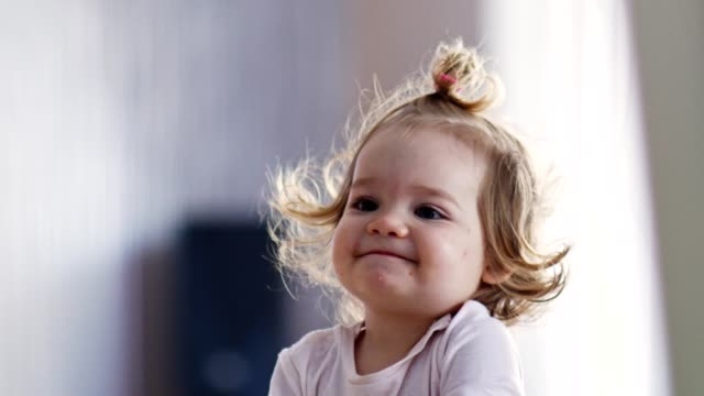 curious baby girl playing at home - hairstyle stock videos & royalty-free footage