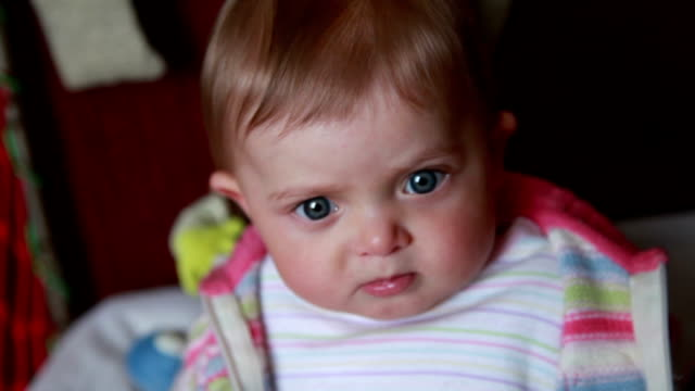 curious baby looking up and down - part of a series stock videos & royalty-free footage