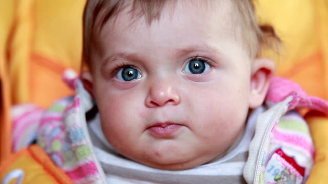 curious baby stares at camera - staring stock videos & royalty-free footage