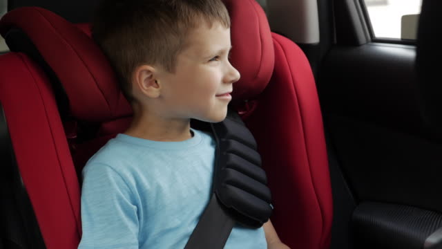 curious boy tells something while driving in infant car seat - comfortable stock videos & royalty-free footage
