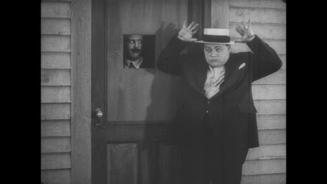 1917 curious man (fatty arbuckle) uses secret code to enter secret betting house - 1917 stock videos & royalty-free footage