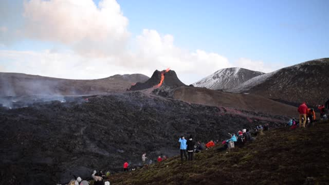 curious onlookers have flocked to an erupting volcano in iceland to marvel at the hypnotic display of glowing red lava - psychedelic stock videos & royalty-free footage