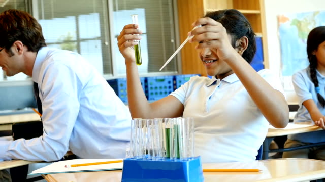 Curious private middle school STEM school student works on science experiment