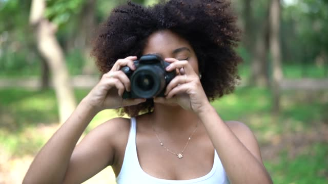 curly hair girl having fun while photographing - pardo brazilian stock videos & royalty-free footage
