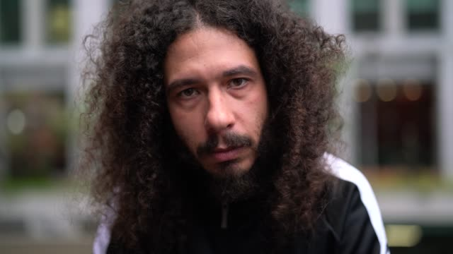 curly hair man serious portrait - rebellion stock videos & royalty-free footage