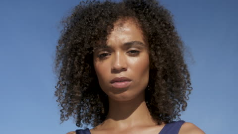 curly haired african american woman, close up - effort stock videos & royalty-free footage