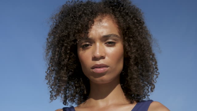 curly haired african american woman, close up - serious stock videos & royalty-free footage