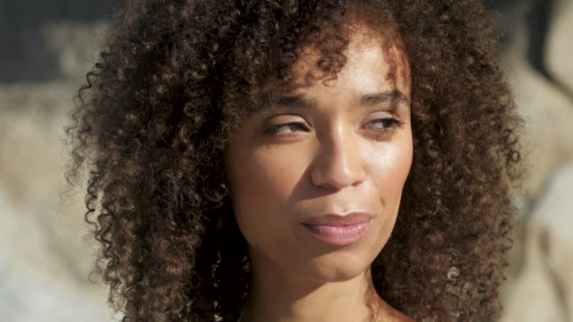 curly haired african american woman, close up - looking away stock videos & royalty-free footage