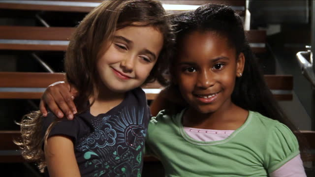 cu curly haired girl and african american girl hugging and smiling / miami, florida, united states  - toothy smile stock videos & royalty-free footage