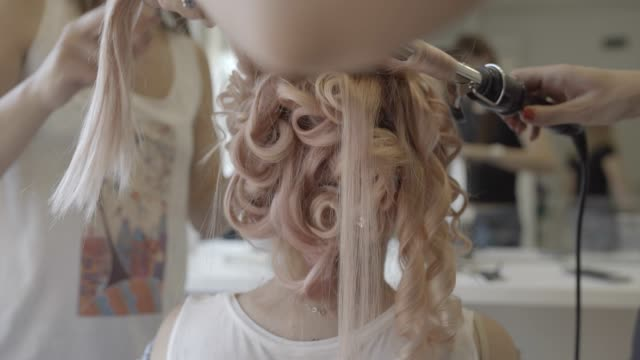 curly hairstyle - beauty salon stock videos and b-roll footage