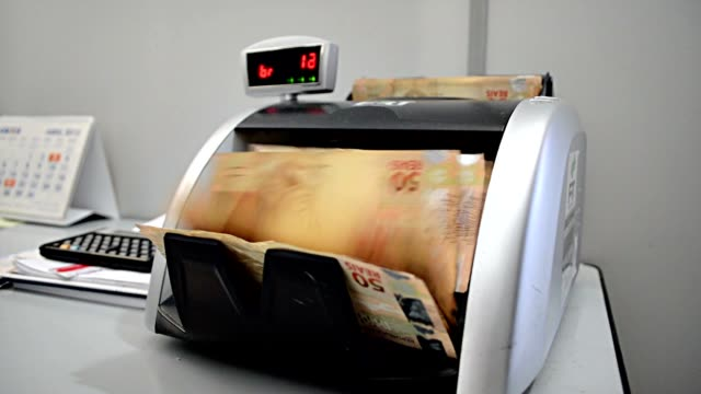 currency-counting machine is counting - financial item stock videos and b-roll footage