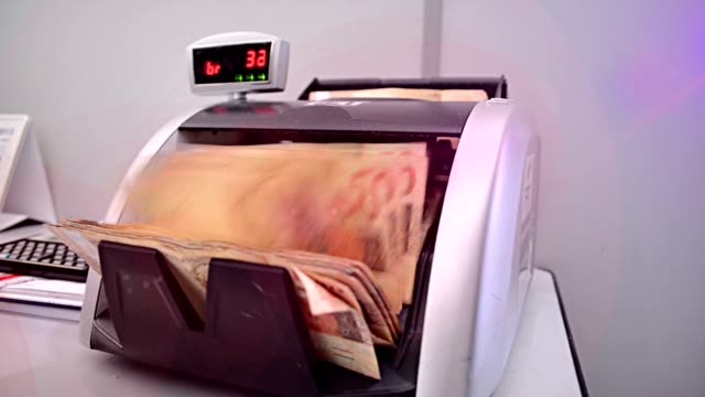 currency-counting machine is counting - banking sign stock videos & royalty-free footage