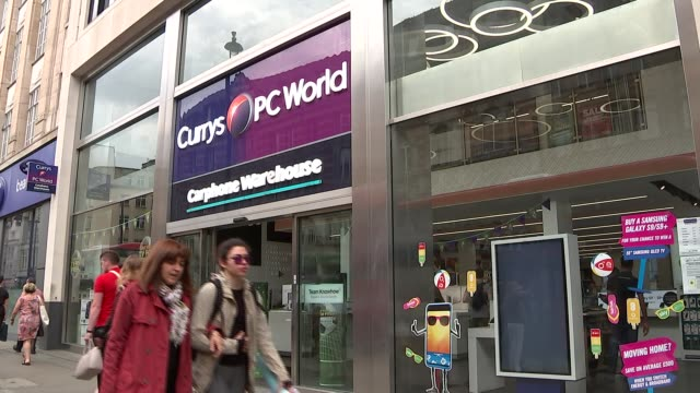 currys pc world store that includes branch of carphone warehouse; uk, london: currys pc world electronics and technology store that includes branch... - warehouse点の映像素材/bロール