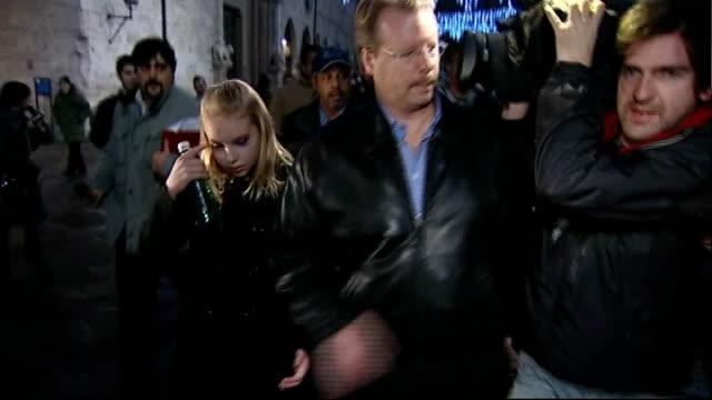 Curt Knox along outside court and pushing back camera operator