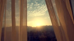 Curtain at the window of room sunset