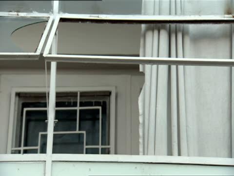 MS Curtains blowing in open window of the International Red Cross building / Kigali, Rwanda