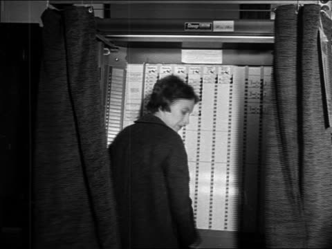 b/w 1964 curtains opening woman exiting voting booth during presidential election / newsreel - voting booth stock videos & royalty-free footage