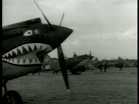curtiss p-40 fighter airplanes parked in field. american volunteer group's officers & pilots going over map on avg jeep pilots standing by p-40... - 1942 stock videos & royalty-free footage