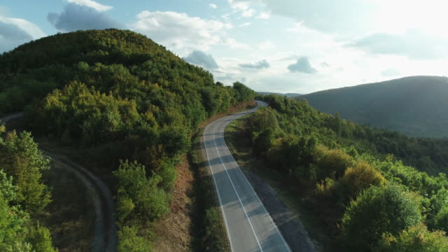 curve mountain road from drone - winding road stock videos & royalty-free footage