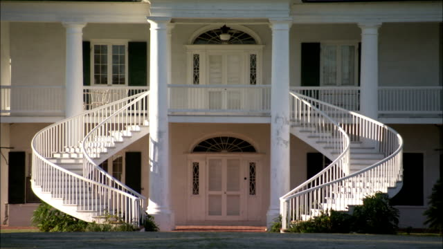 Curved staircases wrap around the front entrance of Evergreen Plantation. Available in HD.