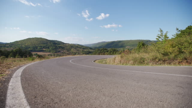 curvy empty country road - low angle view stock videos & royalty-free footage