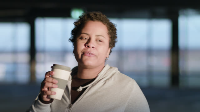 curvy woman drinks from reusable coffee cup and enjoys late sunlight - utensil stock videos & royalty-free footage