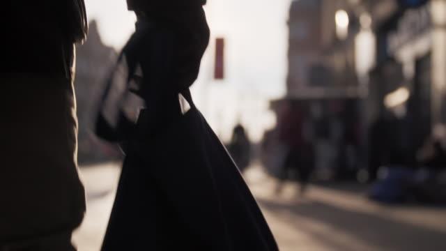 cus a man carries a reusable shopping bag - shopping bag stock videos & royalty-free footage