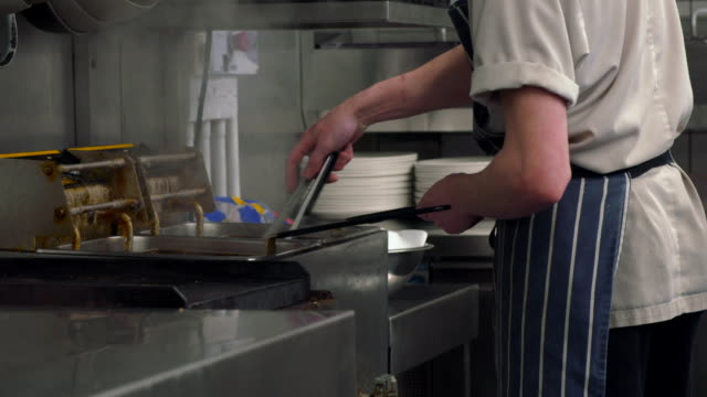 cus chef cooks in restaurant kitchen - apron stock videos & royalty-free footage