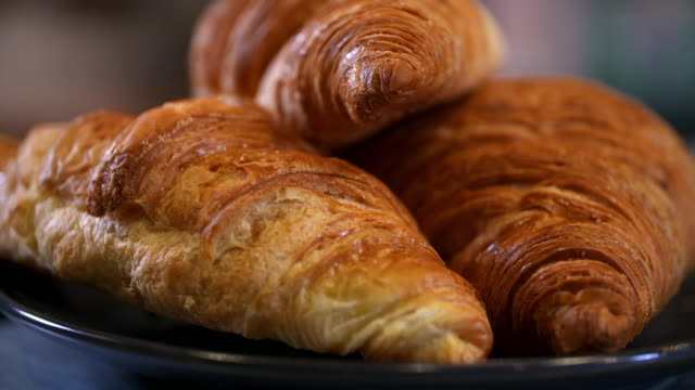 cus coffee and croissants in a french brasserie - france stock videos & royalty-free footage