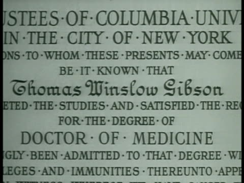 cus columbia university med school diploma for thomas w. gibson. dramatization: actor portraying thomas gibson taking hippocratic oath w/other... - thomas gibson stock videos & royalty-free footage