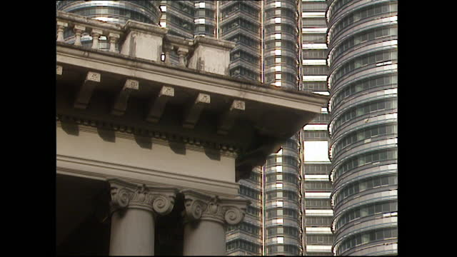 cus contrasting old and new architecture in kuala lumpur; 1996 - design element stock videos & royalty-free footage