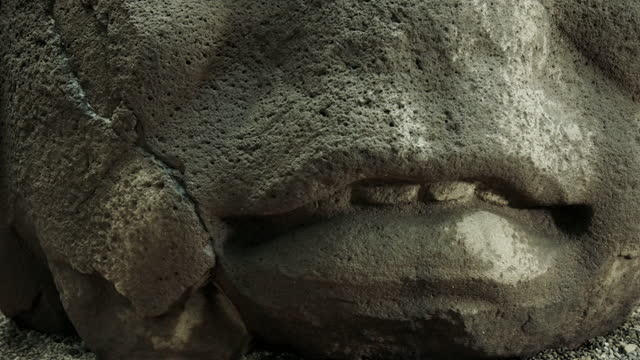 cus facial features of an ancient olmec head, mexico - number 4 stock videos & royalty-free footage
