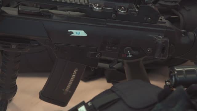 cus guns and protective equipment - machine gun stock videos & royalty-free footage
