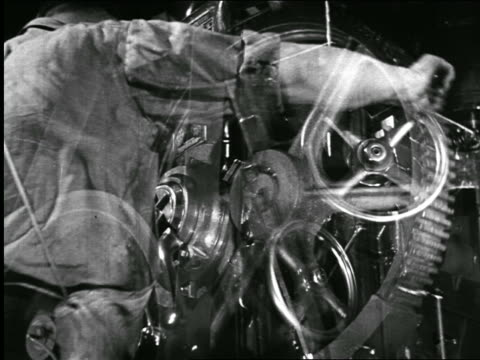 stockvideo's en b-roll-footage met b/w 1940 dissolves cus industrial workers + pulleys in dodge car factory / chrysler documentary - chrysler